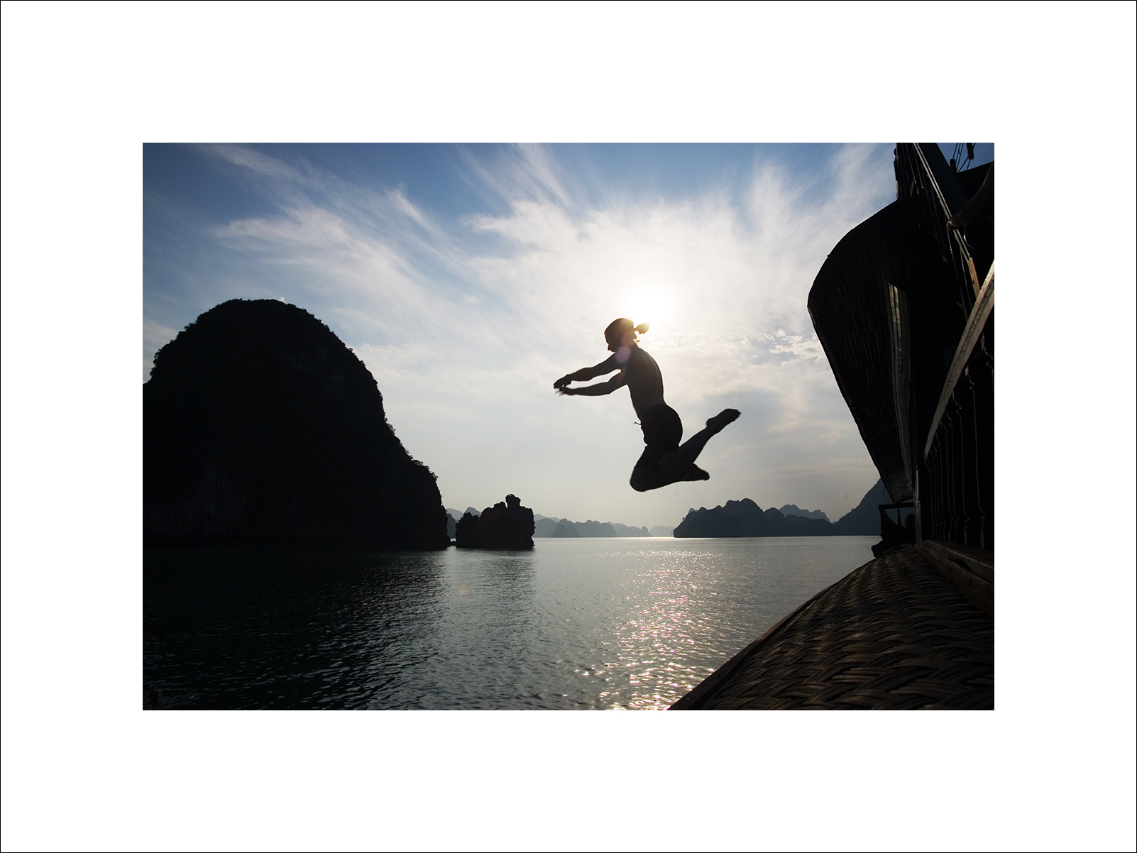Tourist jumping from a junk in Halong Bay