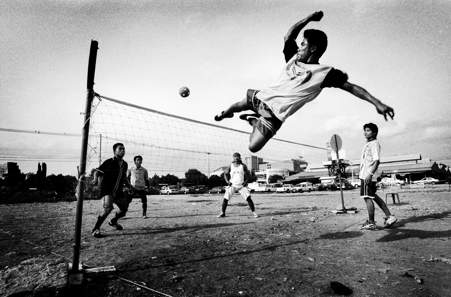 A Takraw player kicks the ball during a takraw game in Bangkok, Thailand