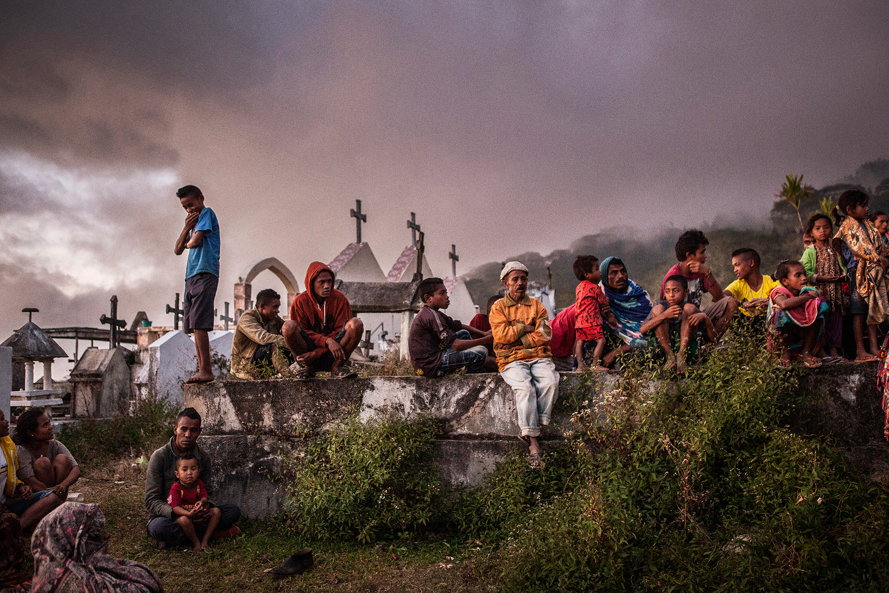 Villagers in a small village close to Atsabe wait for a funeral ceremony to start